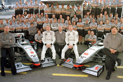 The victorious McLaren Mercedes Team: In front (L-R) Ron Dennis, the winner Mika Hakkinen, Jurgen Schrempp, Daimler-Benz CEO, David Coulthard, 2nd in race and Norbert Haug, Mercedes Sport Chief