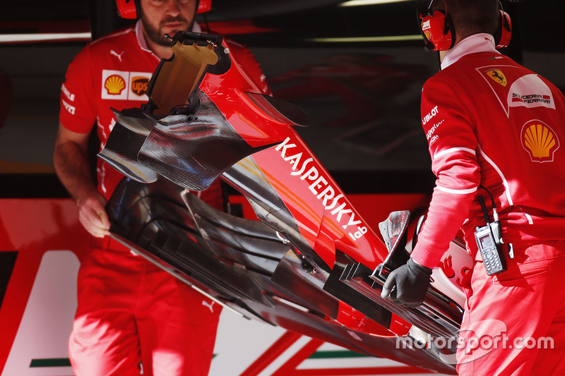 Ferrari SF70H front wing is lifted by mechanics