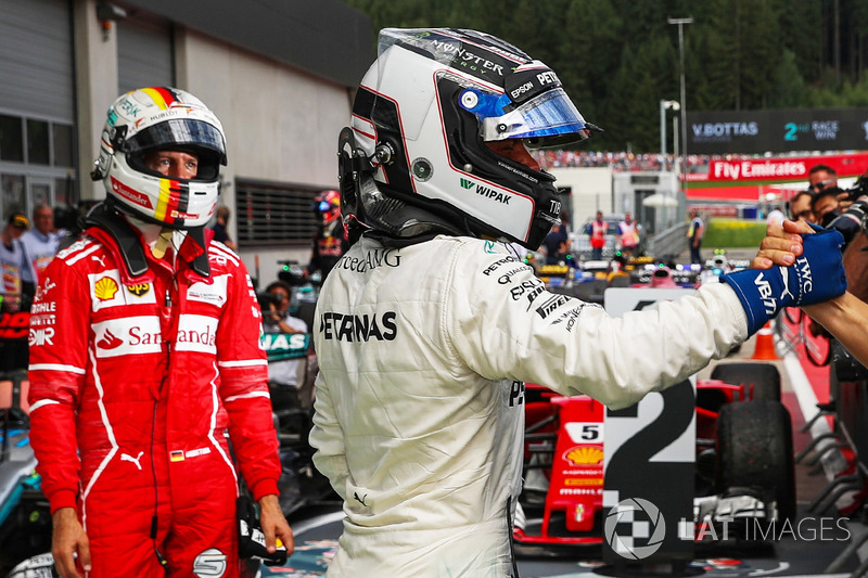 Race winner Valtteri Bottas, Mercedes AMG F1 and second place Sebastian Vettel, Ferrari celebrate in parc ferme