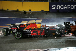 The cars of Kimi Raikkonen, Ferrari SF70H and Max Verstappen, Red Bull Racing RB13 crash and collide