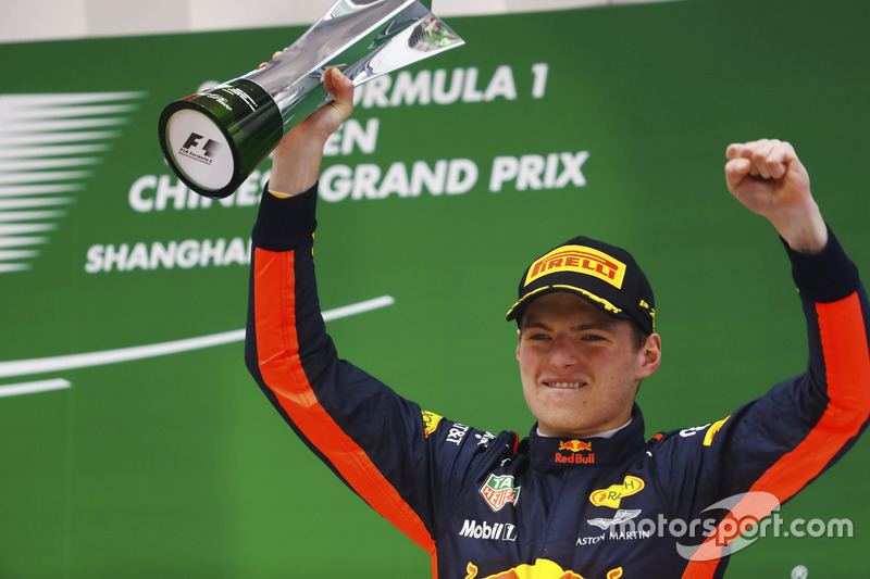 Max Verstappen, Red Bull Racing, celebrates with his trophy on the podium