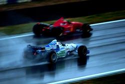 Michael Schumacher, Ferrari F310; Gerhard Berger, Benetton B196