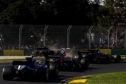 Kevin Magnussen, Haas F1 Team VF-17, collides with Marcus Ericsson, Sauber C36
