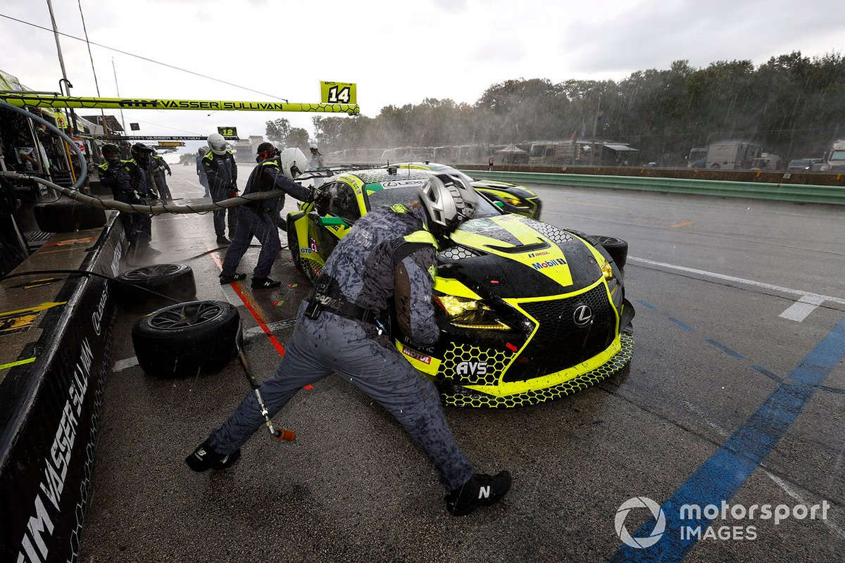 The #14 Lexus of Hawksworth/Telitz gets beaten out of pitlane by the sister car of Bell/Montecalvo in the rain-soaked closing stages of the Road America race.