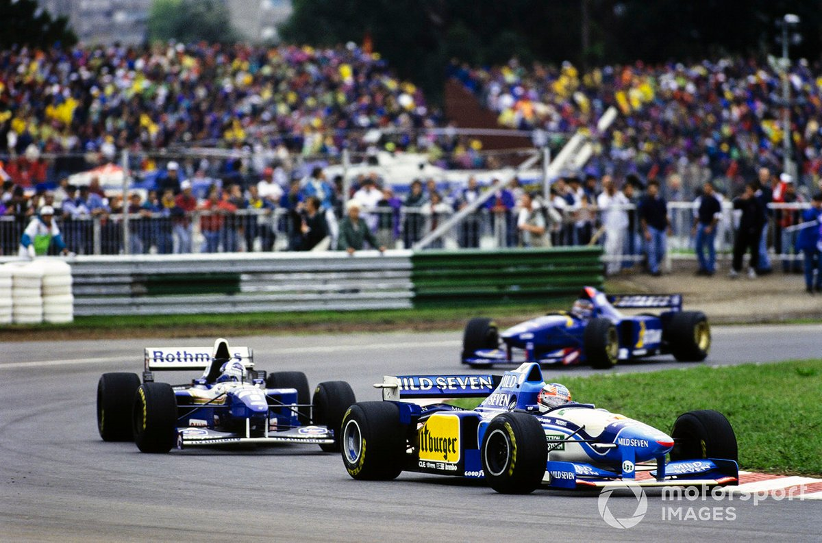 Michael Schumacher, Benetton B195 Renault, leads David Coulthard, Williams FW17 Renault