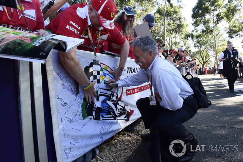 Chase Carey, Chief Executive Officer and Executive Chairman of the Formula One Group signs autograph