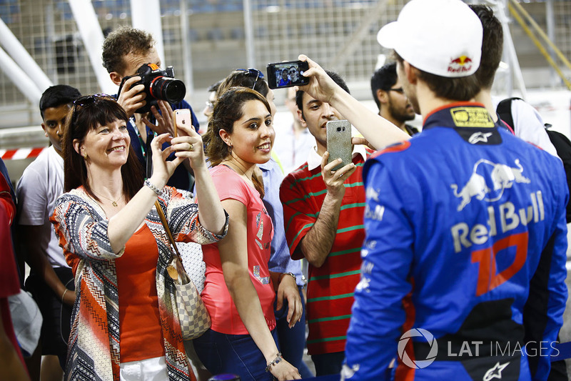 Fans take pictures of Pierre Gasly, Toro Rosso