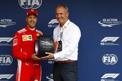 Sebastian Vettel, Ferrari, receives the Pirelli pole position award