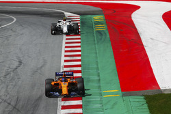 Fernando Alonso, McLaren MCL33, leads Charles Leclerc, Sauber C37, to the grid