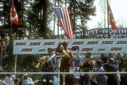 Podium: winner Eddie Lawson, second place Freddie Spencer, third place Randy Mamola