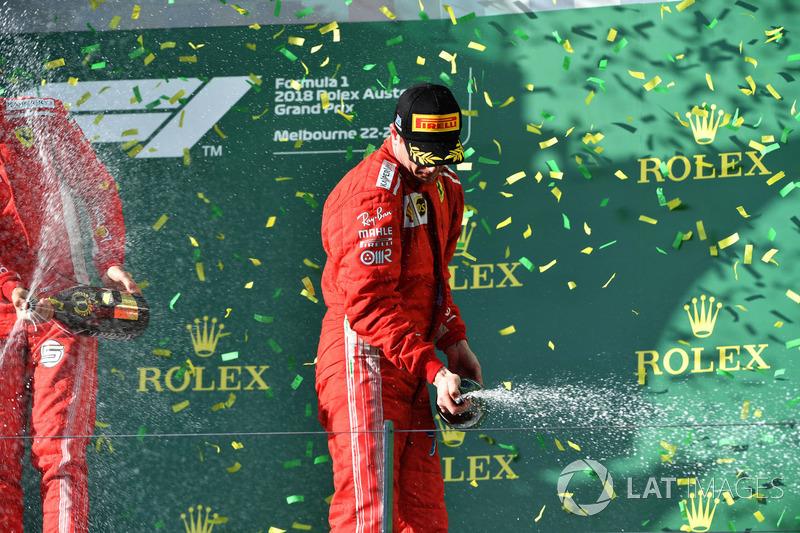 Kimi Raikkonen, Ferrari celebrates on the podium with the champagne