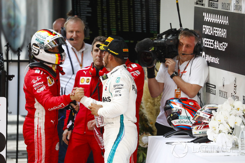 Race winner Sebastian Vettel, Ferrari, Inaki Rueda, Race Strategist, Ferrari, Kimi Raikkonen, Ferrari, 3rd position. and Lewis Hamilton, Mercedes AMG F1, 2nd position