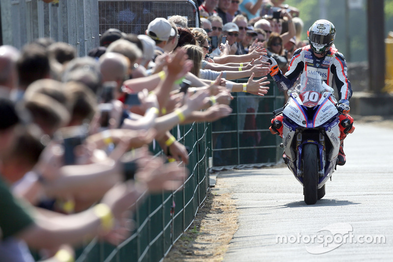 Peter Hickman celebrates winning the RL360º Superstock TT race