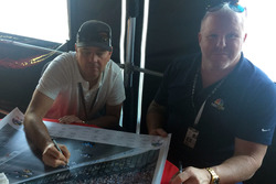 Jimmy Vasser and Paul Tracy sign Justin Wilson poster