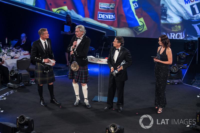 Nelson Piquet receives a lifetime achievement award from Gordon Murray