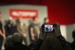 Fans film Gordon Shedden, Matt Neal, Andrew Jordan, Colin Turkington and Ashley Sutton talking to Henry Hope-Frost on the Autosport Stage