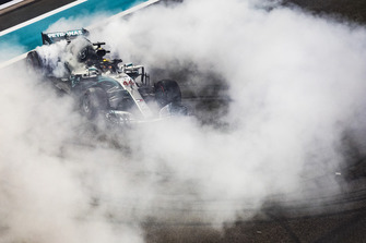 world champion, performs donuts on the grid at the end of the race