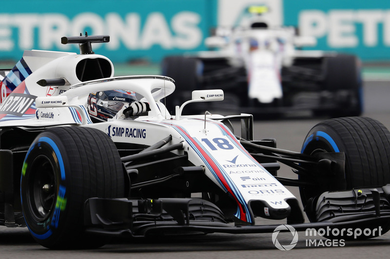 Lance Stroll, Williams FW41, leads Sergey Sirotkin, Williams FW41