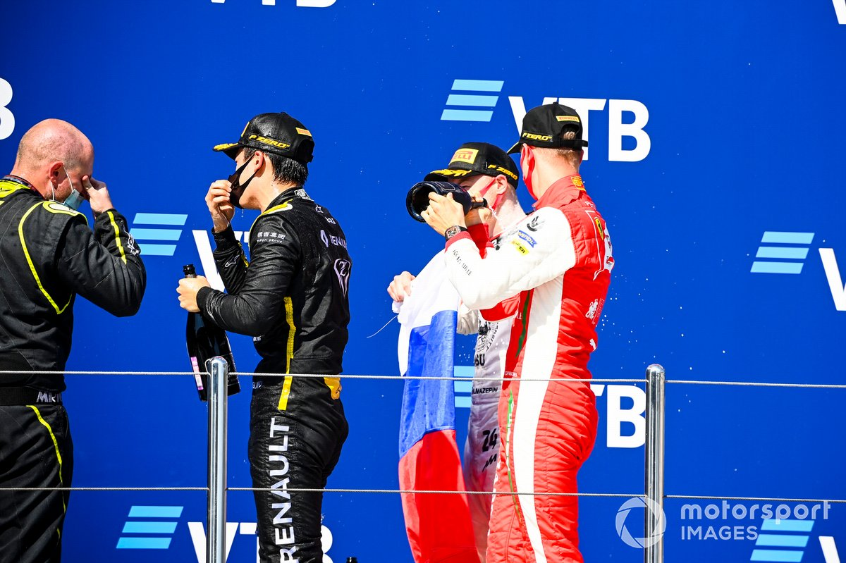 Winning Constructor Representative, Guanyu Zhou, UNI-Virtuosi, Nikita Mazepin, Hitech Grand Prix and Mick Schumacher, Prema Racing celebrate on the podium with the champagne