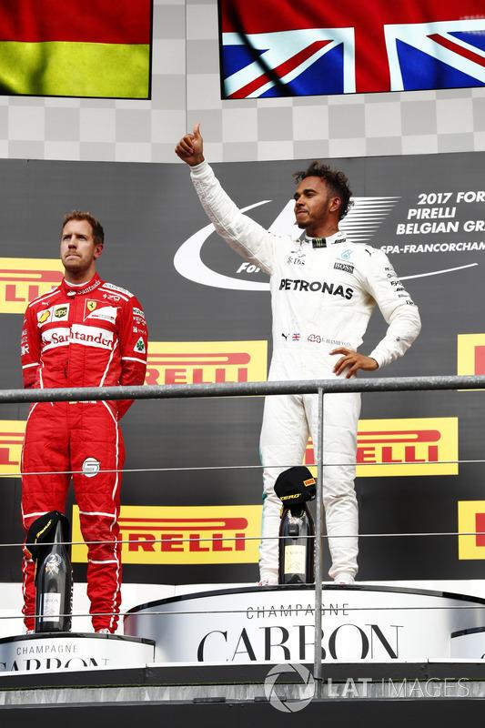 Lewis Hamilton, Mercedes AMG F1 alongside Sebastian Vettel, Ferrari