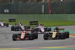 Fernando Alonso, McLaren MCL32, battles Nico Hulkenberg, Renault Sport F1 Team RS17, ahead of Esteban Ocon, Sahara Force India F1 VJM10, Kevin Magnussen, Haas F1 Team VF-17