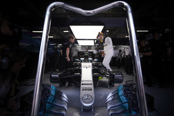 Lewis Hamilton, Mercedes AMG, climbs in to his car
