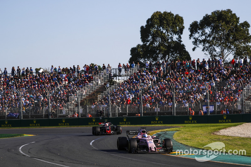 Sergio Perez, Force India VJM10, leads Kevin Magnussen, Haas F1 Team VF-17