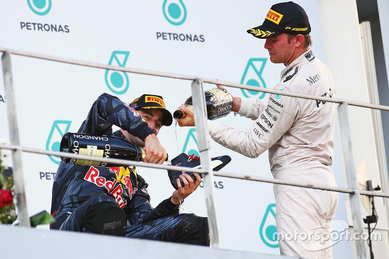 Race winner Daniel Ricciardo, Red Bull Racing celebrates on the podium with Nico Rosberg, Mercedes A