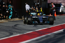 Lewis Hamilton, Mercedes F1 W08, powers away from a pit stop