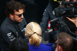 Fernando Alonso, McLaren, talks to the media in the paddock
