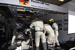 Crew members work on the #2 Porsche Team Porsche 919 Hybrid: Timo Bernhard, Earl Bamber, Brendon Hartley