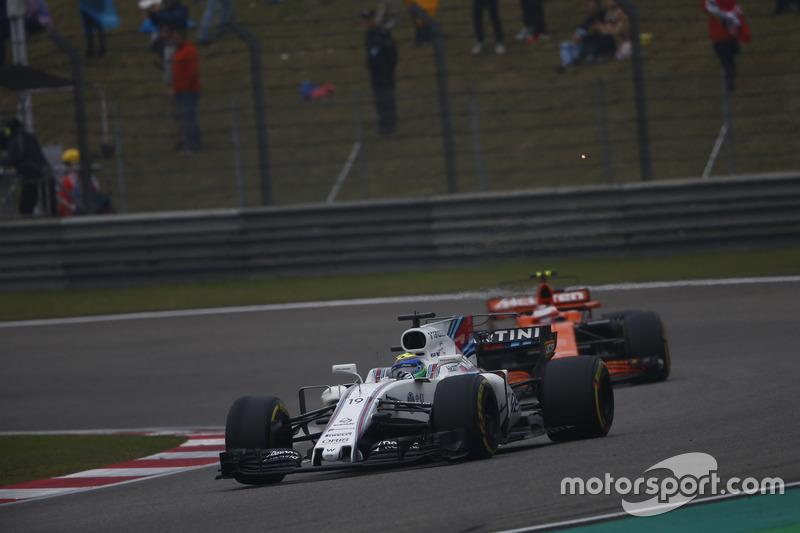 Felipe Massa, Williams FW40, leads Stoffel Vandoorne, McLaren MCL32