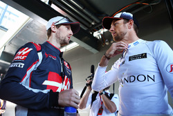 Romain Grosjean, Haas F1 Team with Jenson Button, McLaren