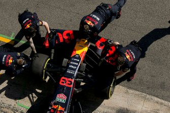 Max Verstappen, Red Bull Racing, is attended to by mechanics in the pit lane