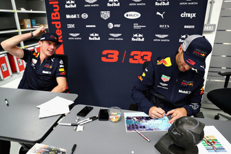 Max Verstappen, Red Bull Racing and Daniel Ricciardo, Red Bull Racing sign autographs