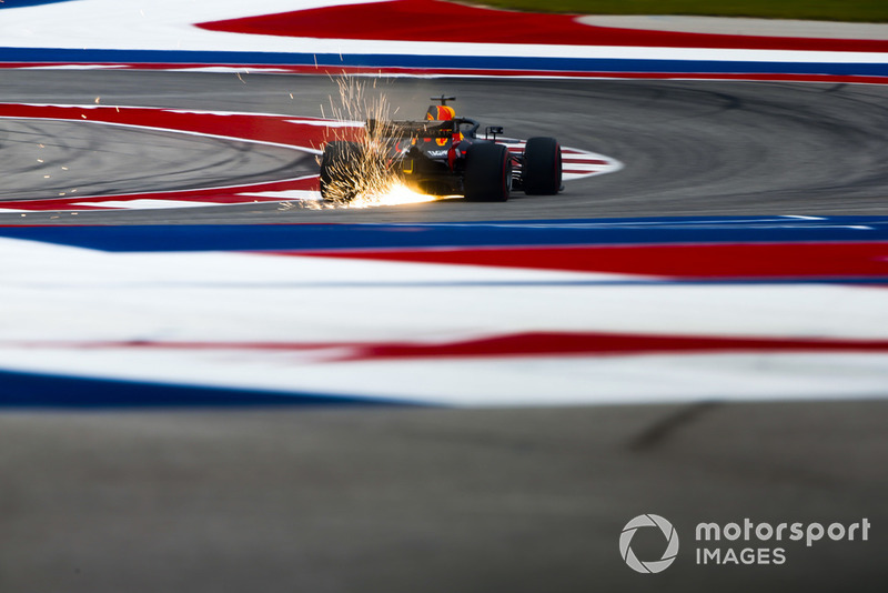 4. Sparks fly from the rear of Daniel Ricciardo, Red Bull Racing RB14