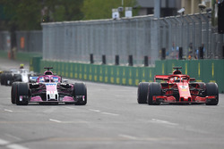 Sebastian Vettel, Ferrari SF71H and Sergio Perez, Force India VJM11