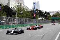 Valtteri Bottas, Mercedes AMG F1 W09, leads Sebastian Vettel, Ferrari SF71H, Lewis Hamilton, Mercedes AMG F1 W09, and Kimi Raikkonen, Ferrari SF71H at the restart
