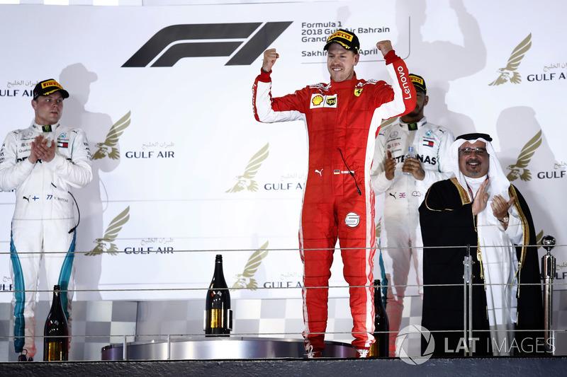 Valtteri Bottas, Mercedes AMG F1, 2nd position, Sebastian Vettel, Ferrari, 1st position, and Lewis Hamilton, Mercedes AMG F1, 3rd position, on the podium