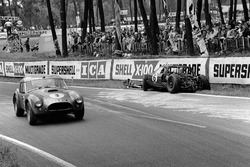 eter Bolton, Ninian Sanderson, AC Cobra 289 Ford Coupe, passes the wreckage of Richard Attwood, David Hobbs, Lola GT Mk 6 Ford