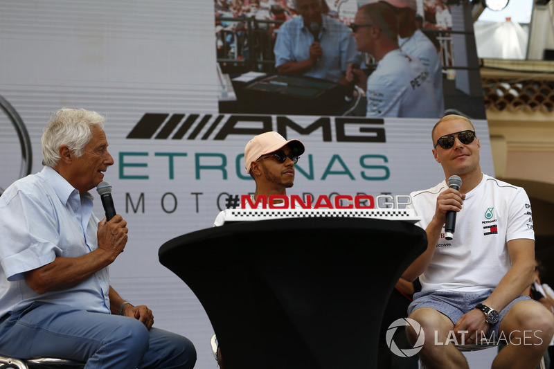Lewis Hamilton, Mercedes-AMG F1 and Valtteri Bottas, Mercedes-AMG F1 on stage with Bob Constanduros