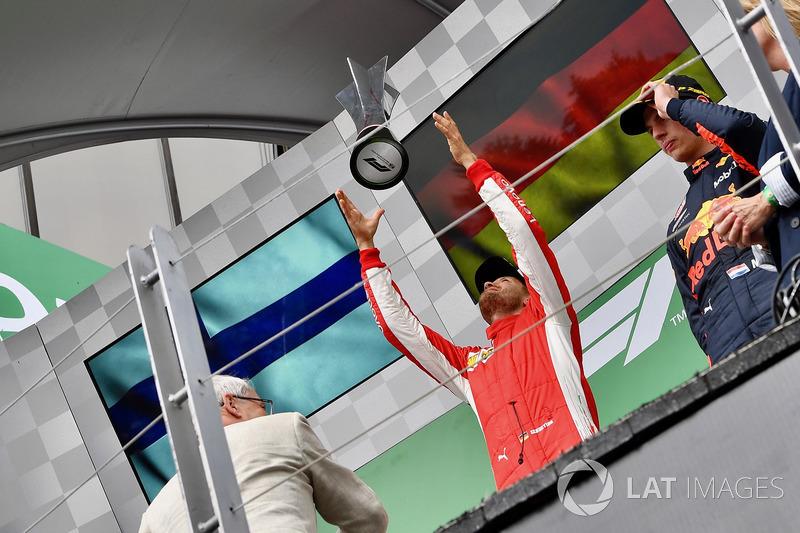 Race winner Sebastian Vettel, Ferrari celebrates with the trophy on the podium