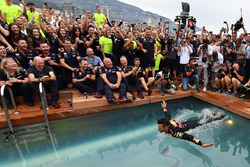 Race winner Daniel Ricciardo, Red Bull Racing celebrates in the Red Bull Energy Station swimming pool
