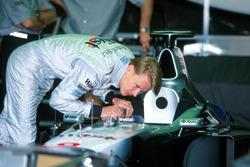 Race winner Mika Hakkinen,McLaren checks his cockpit