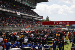 The grid stands to attention for the national anthem