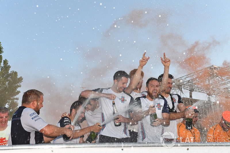 Williams celebrate on the podium at the raft race