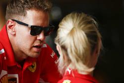 Sebastian Vettel, Ferrari, talking to his press officer