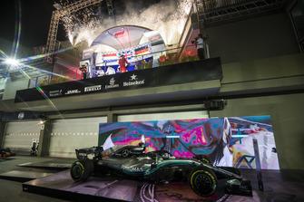 Lewis Hamilton, Mercedes AMG F1, 1st position, Max Verstappen, Red Bull Racing, 2nd position, and Sebastian Vettel, Ferrari, 3rd position, celebrate on the podium