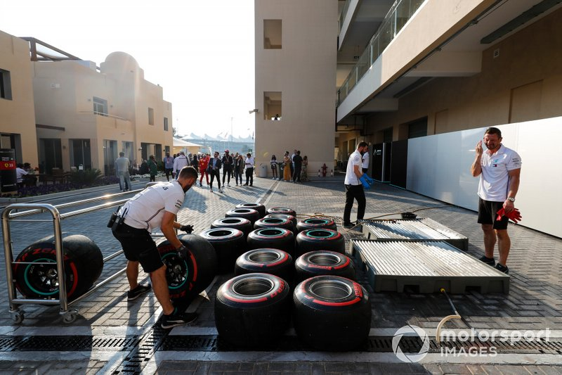 Mercedes mechanics prepare some tyres