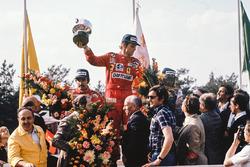 Race winner Niki Lauda, Ferrari, celebrates with second place Clay Regazzoni, Ferrari and third place Jacques Laffite on the podium